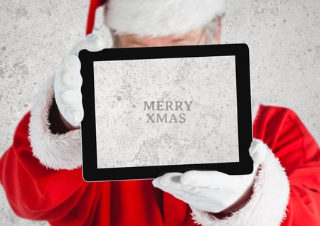 xmass: Close-up of hands of santa claus holding a digital tablet with text marry xmass