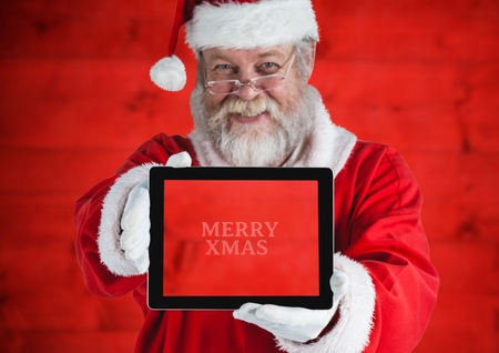 xmass: Portrait of santa claus holding a digital tablet with text marry xmass
