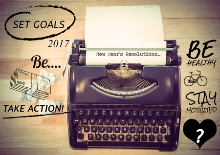 paper wad: New years resolutions against typewriter with paper on wooden background