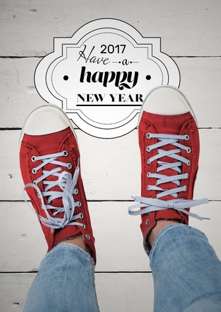 inches: 2017 new year wishes with teenager wearing red sneakers against wooden background