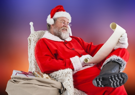 wish  list: Santa claus sitting on chair and reading wish list