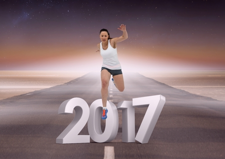 Composite image of 2017 with sports girl running on road during day