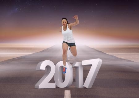 altruismo: Imagen compuesta de 2017 con la muchacha de los deportes que se ejecuta en la carretera durante el día Foto de archivo