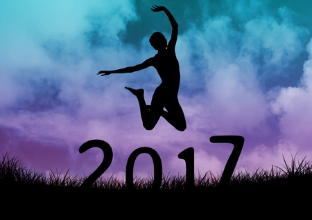 outstretched: Silhouette of woman jumping over 2017 new year sign against blue and purple sky