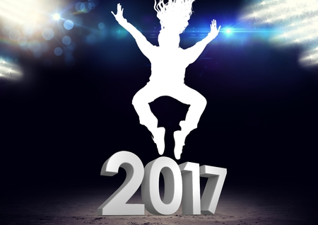 outstretched: Silhouette of person jumping over 2017 new year sign against digitally generated background