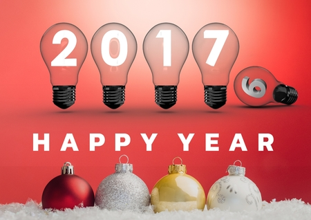 2017 sign inside light bulbs with colorful christmas baubles against red background
