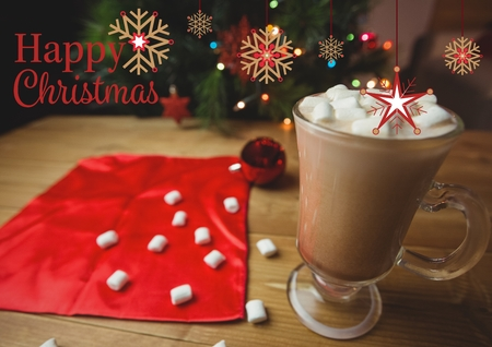 Happy Christmas greetings with coffee and marshmallow in glass on table