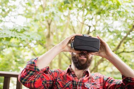 Man using virtual reality headset in bar LANG_EVOIMAGES