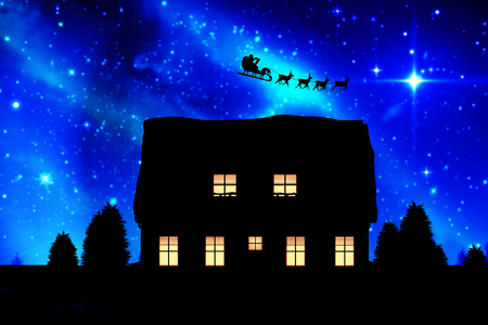 Side view of Santa Claus riding on sleigh during Christmas against aurora shimmering over forest at night