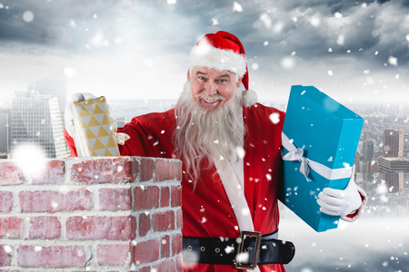 Portrait of Santa Claus placing gift boxes into chimney against room with large window looking on city