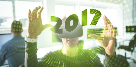 convenient: Digital image of new year 2017 against green pixel spiral Stock Photo
