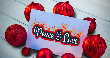 plain postcards: Red christmas baubles surrounding white page against bleached wooden planks background