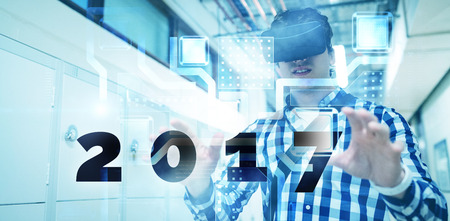 mid adult men: Digital image of new year 2017 against abstract technology interface Stock Photo