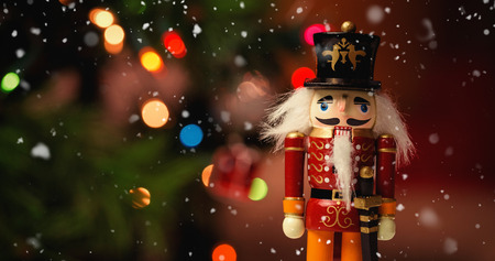 solider: Snow falling against close-up of nutcracker toy solider christmas decoration