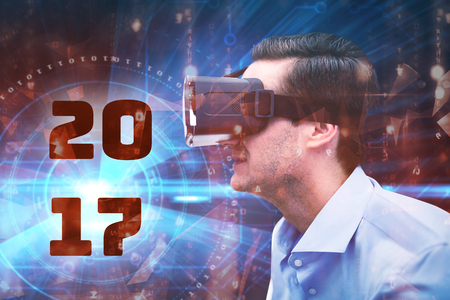 against abstract: Profile view of businessman holding virtual glasses against abstract background
