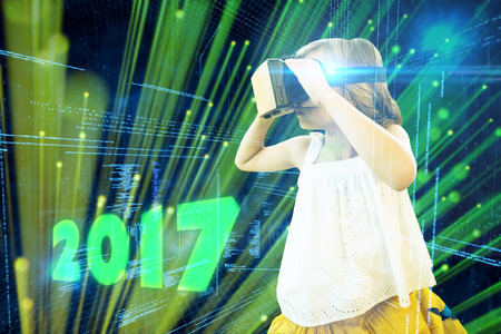 virtual reality simulator: Girl wearing virtual reality simulator against digitally generated black and blue matrix Stock Photo