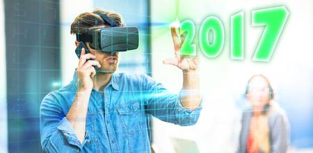 phoning: Digital image of new year 2017 against digital grid