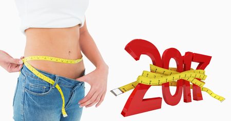 3D Mid section of a woman measuring waist in a big sized jeans against new year with tape measure