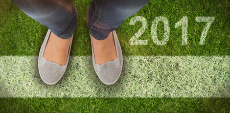 casually dressed: Casually dressed womans feet against closed up view of grass