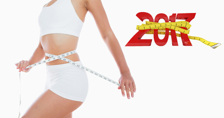 waist: 3D Woman measuring waist against new year with tape measure