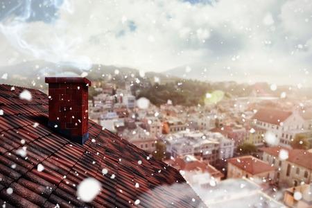 3D Snow falling against city landscape Stock Photo