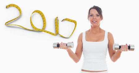 3D Portrait of young woman exercising with dumbbells against 2017 made of measuring tape