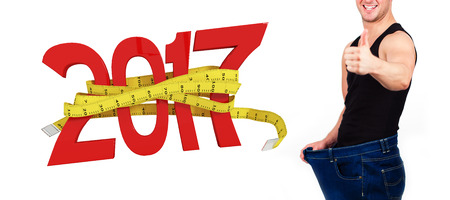 3D Digitally generated image of new year with tape measure against portrait of man happy after losing weight Stock Photo
