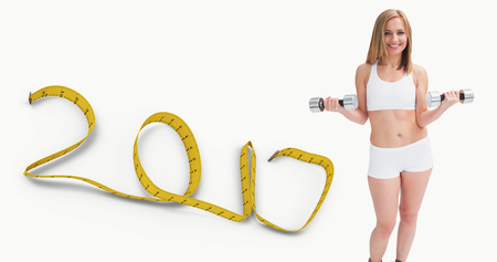 women working out: 3D Portrait of young woman exercising with dumbbells against 2017 made of measuring tape
