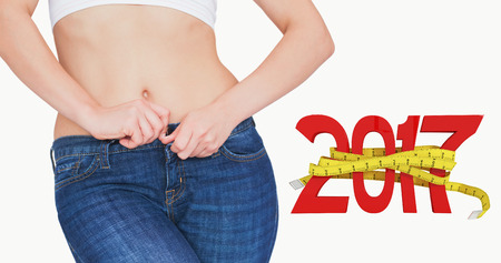 midsection: 3D Midsection of slim woman buttoning jeans against new year with tape measure