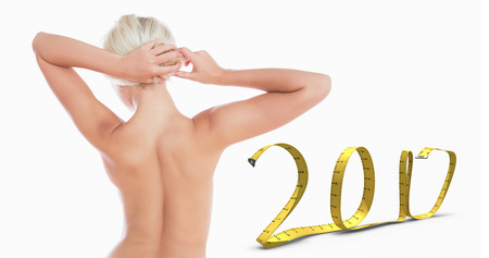 3D Topless woman tying hair against 2017 made of measuring tape