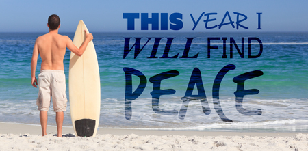 This year i will find peace against man wirth his surfboard on the beach Stock Photo