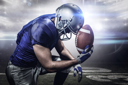 3D Upset American football player with ball against american football arena