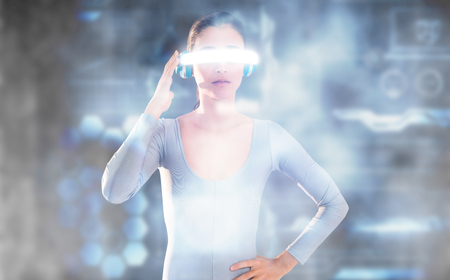 3D Beautiful woman using virtual video glasses against black background Stock Photo