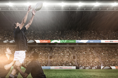 3D Rugby fans in arena against rugby players jumping for line out