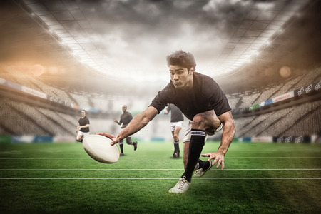3D Rugby stadium against rugby players training on pitch