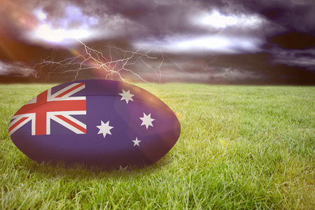 ball lightning: 3D australia rugby ball against stormy sky over field with lightning