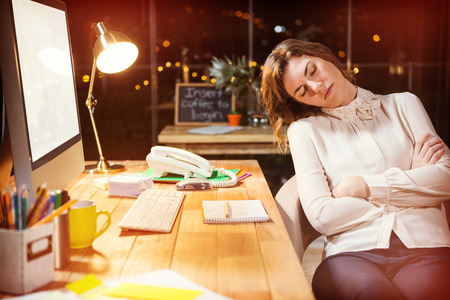hands work: Tired businesswoman sleeping on chair in office Stock Photo