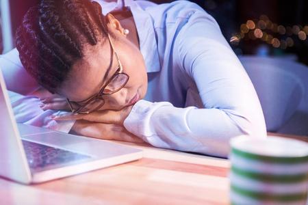 Tired businesswoman sleeping at desk in office Reklamní fotografie