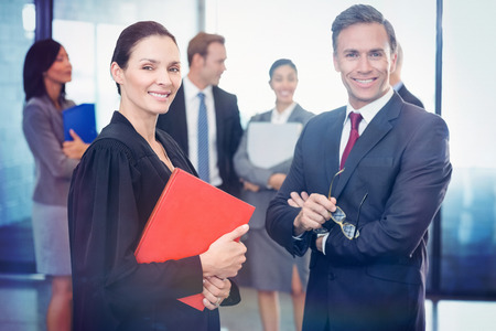 Portrait of businessman standing with lawyer in office Stock Photo