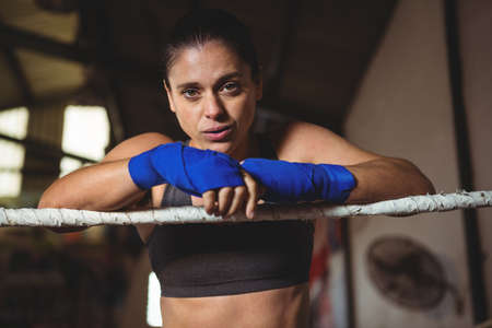 female boxer: Portrait of female boxer standing in boxing ring LANG_EVOIMAGES