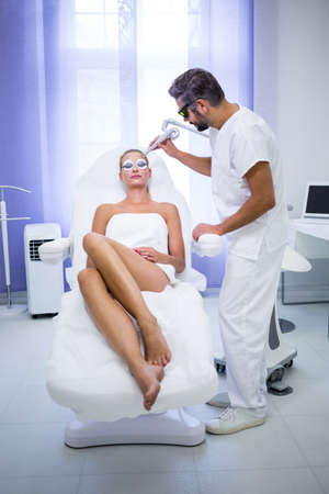 rf: Female patient getting rf lifting procedure in a beauty saloon