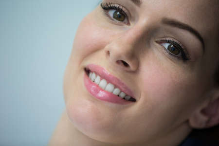 oral communication: Close-up of beautiful woman at dental clinic