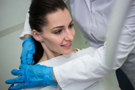 oral communication: Dentist preparing patient for dental check-up in dental clinic LANG_EVOIMAGES