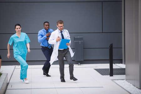 premises: Doctors and nurses rushing for emergency in hospital premises