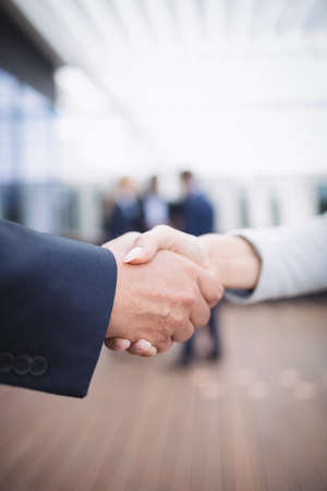 Close-up of businesspeople shaking hands LANG_EVOIMAGES