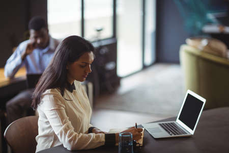 technology: Businesswoman working at her desk in office