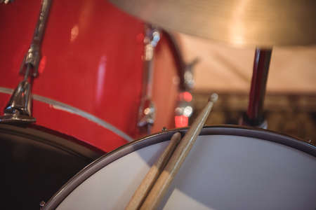 snare drum: Close-up of snare drum with drum sticks in recording studio