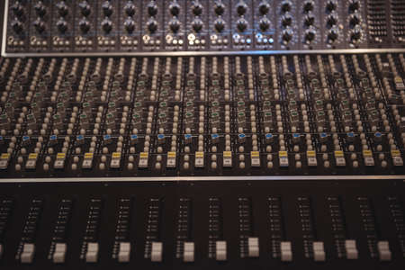 Close-up of sound mixer in a recording studio LANG_EVOIMAGES