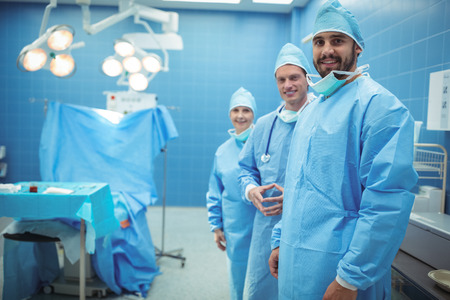 operative: Portrait of male and female surgeon standing with in operation theater at hospital