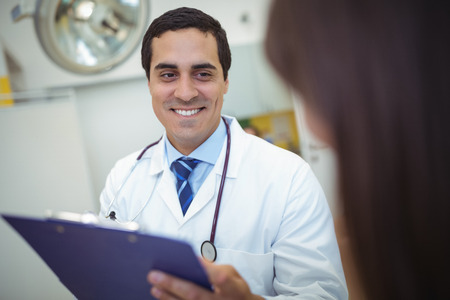 Doctor interacting with patient at hospital